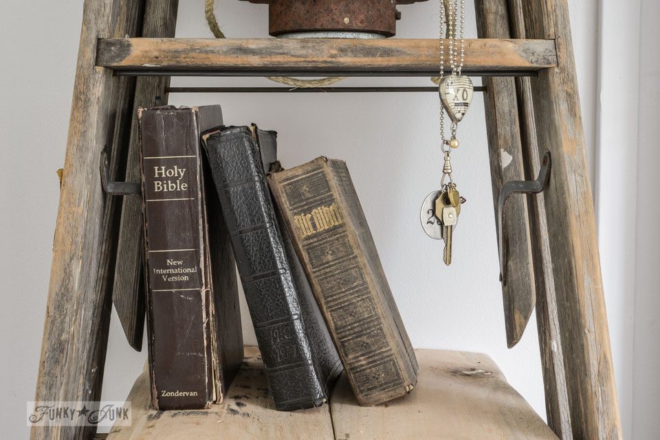 Antique bibles on a shelf / Make a stepladder side table via FunkyJunkInteriors.net