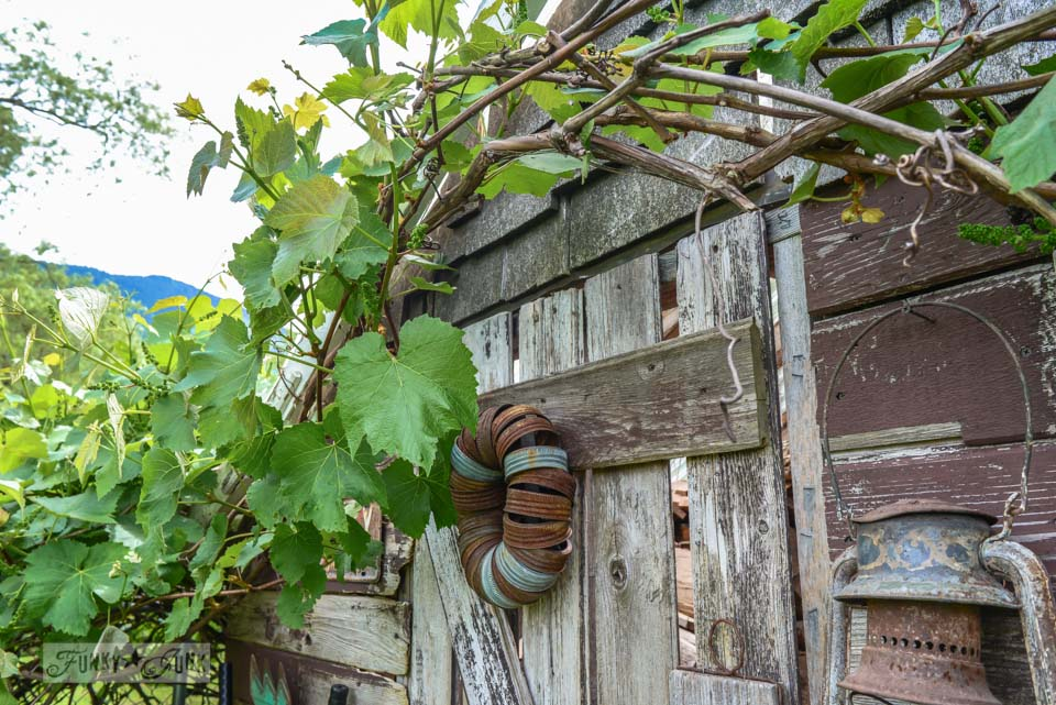 Rusty Canning Jar Wreath On A Shed Rustic Garden With Old Signs Tools