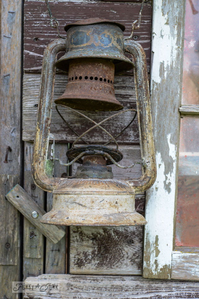 Rusty old lantern / Rustic garden shed with old signs, tools and a grapevine, on FunkyJunkInteriors.net