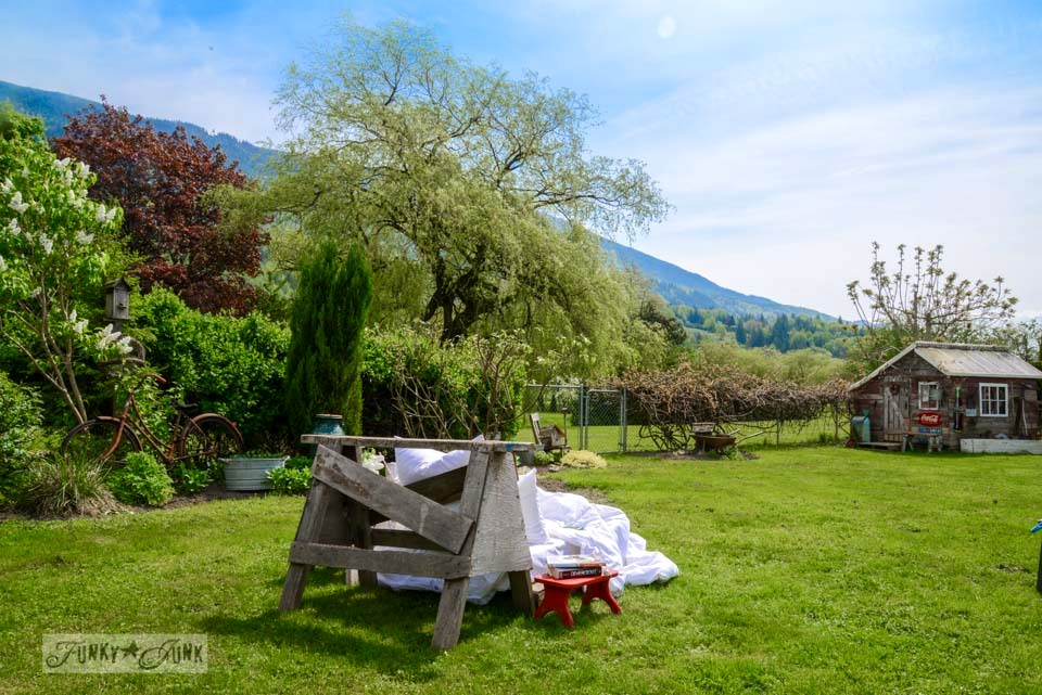 Yard with a mountain view and sawhorse pallet outdoor lounger via FunkyJunkInteriors.net