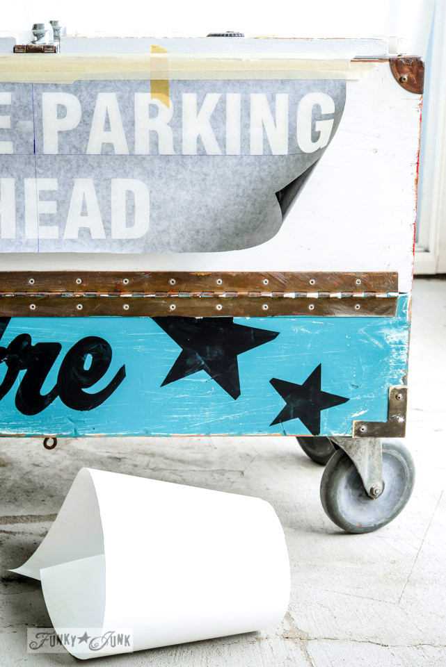 Creating vintage signs on the side of an old toolbox / FunkyJunkInteriors.net