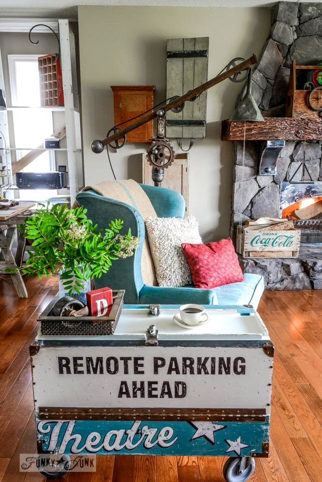 An old sign toolbox side table to store all those remotes! via FunkyJunkInteriors.net
