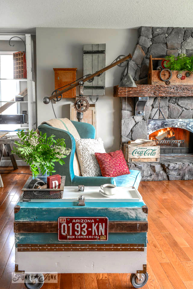 A signed up toolbox side table to hide all those remotes! via FunkyJunkInteriors.net
