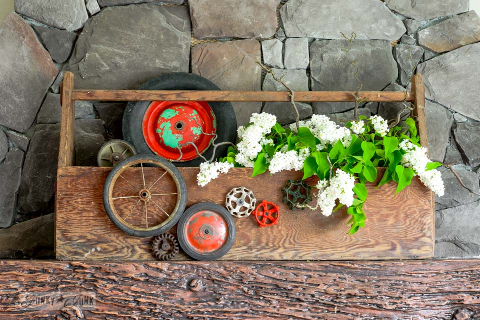 Toolbox planter with wheels, tap handles and white lilacs via FunkyJunkInteriors.net