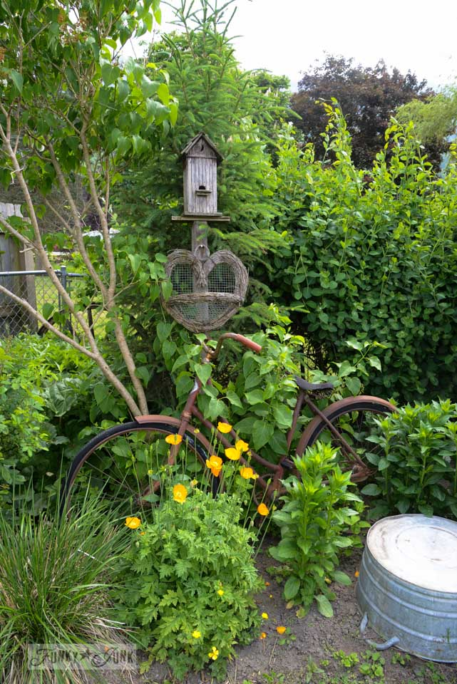 Flowerbed with an old bike / Living with a less than Pinterest worthy yard on FunkyJunkInteriors.net