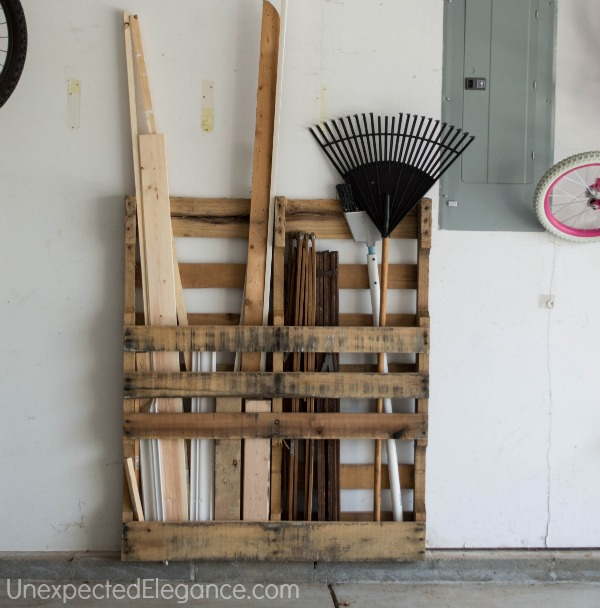 Pallet storage in a workshop, by Unexpected Elegance, featured on FunkyJunkInteriors.net