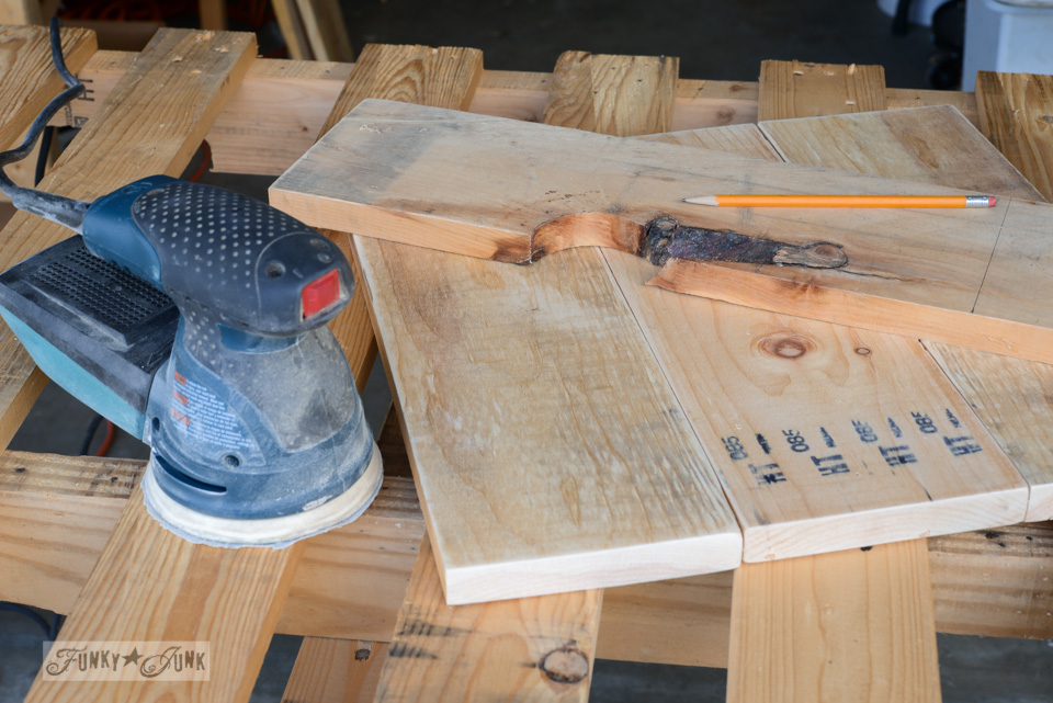 Sanding table planks / How to make a crate side table with tray via FunkyJunkInteriors.net