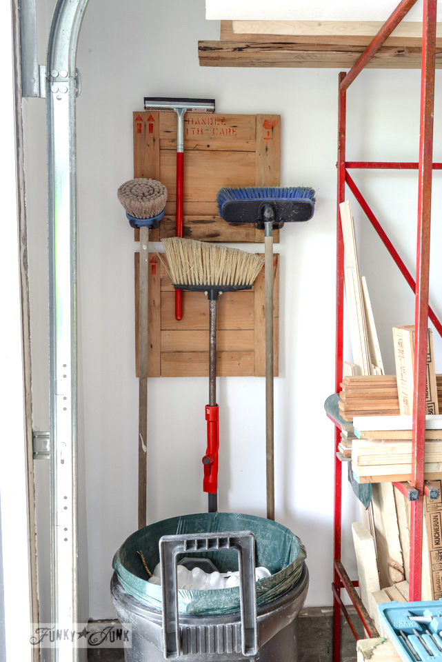 Crate ends broom hanger in a workshop / FunkyJunkInteriors.net