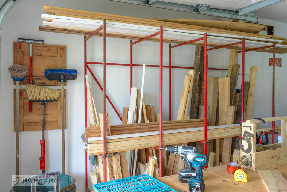 Folding workshop bench / The dumpster found metal storage rack for reclaimed wood is now full! Isn't it a beauty! via FunkyJunkInteriors.net