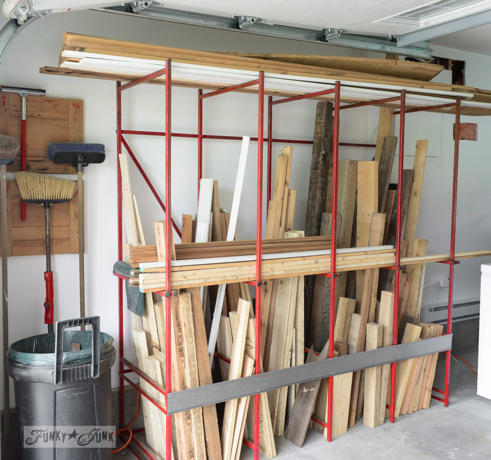 Pallet wood storage in a dumpster metal rack / FunkyJunkInteriors.net