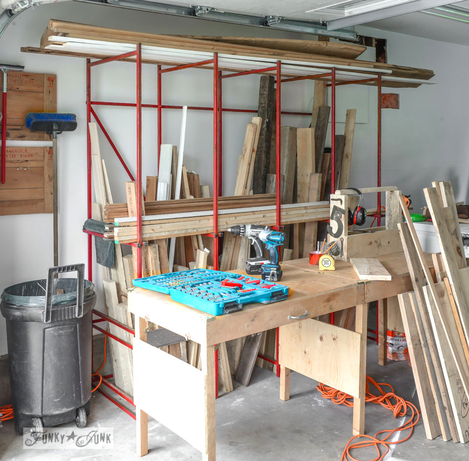 Inspiring workshop filled with reclaimed wood and foldable workbench via FunkyJunkInteriors.net