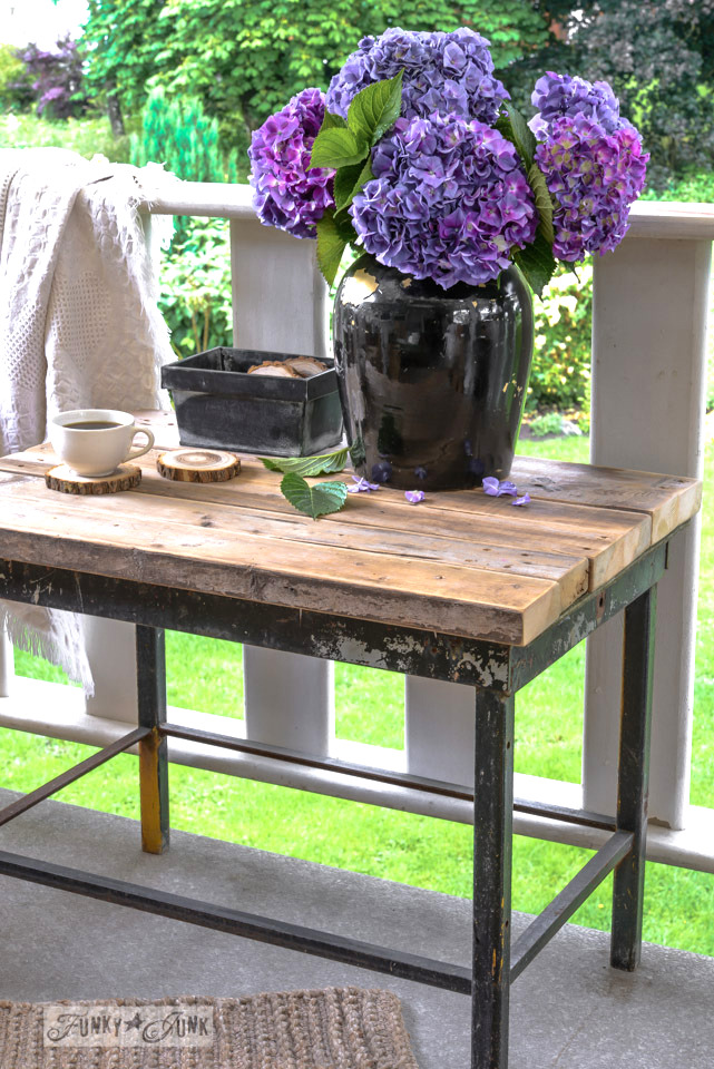 Reclaimed 2x4 enhanced patio table with firewood coasters via FunkyJunkInteriors.net