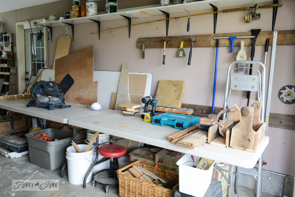 Folding Costco tables used as a workshop workbench via FunkyJunkInteriors.net