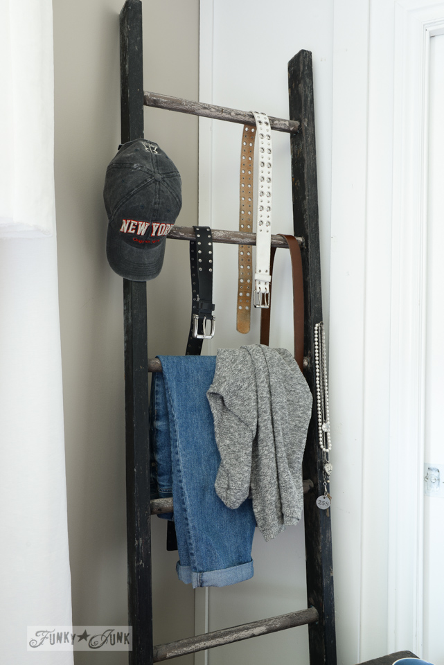 Ladder clothes rack in bedroom via FunkyJunkInteriors.net
