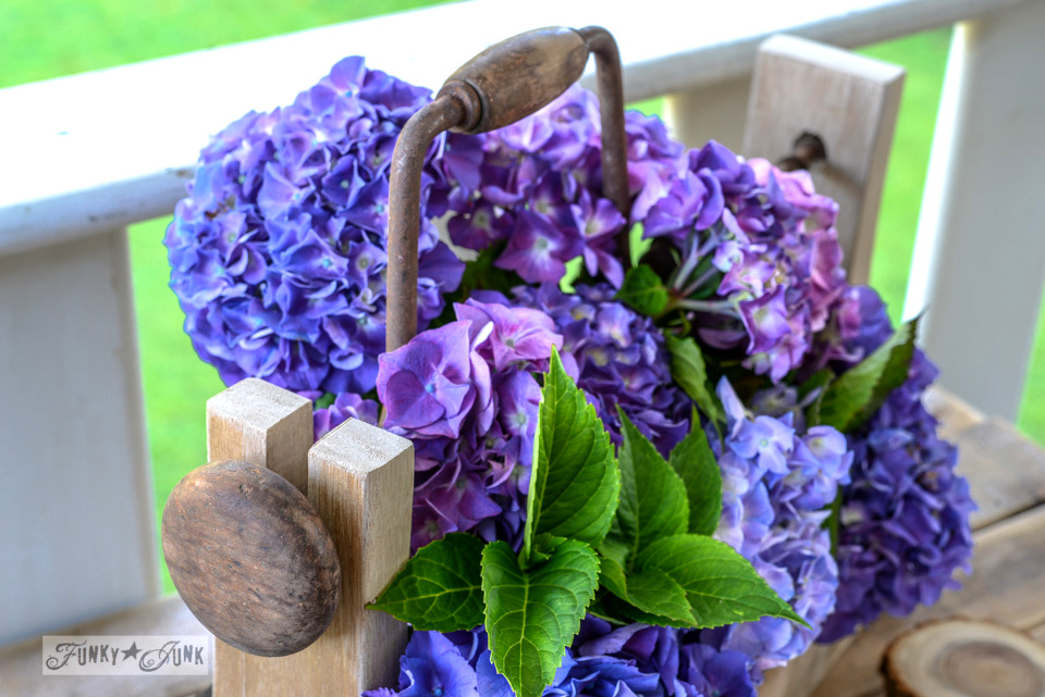 Purple hydrangeas / How to make a pallet wood drill handled toolbox planter via FunkyJunkInteriors.net