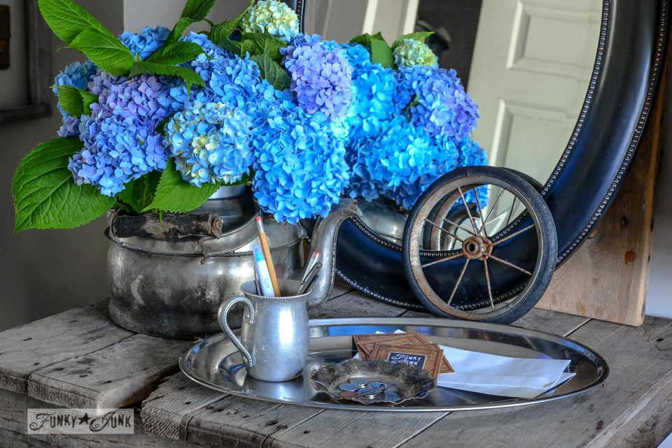Blue hydrangeas with a change tray / One gutsy junk style entry table made from who knows what!  via FunkyJunkInteriors.net