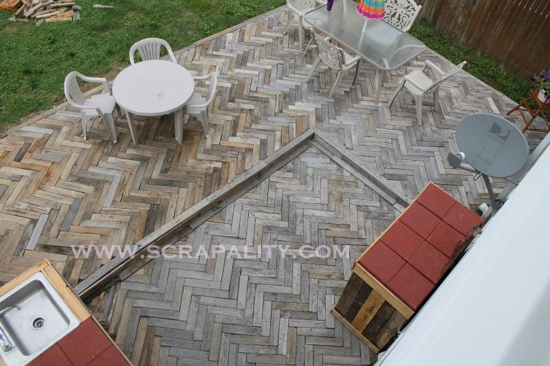 Herringbone pallet wood outdoor deck by Scrapality Designs