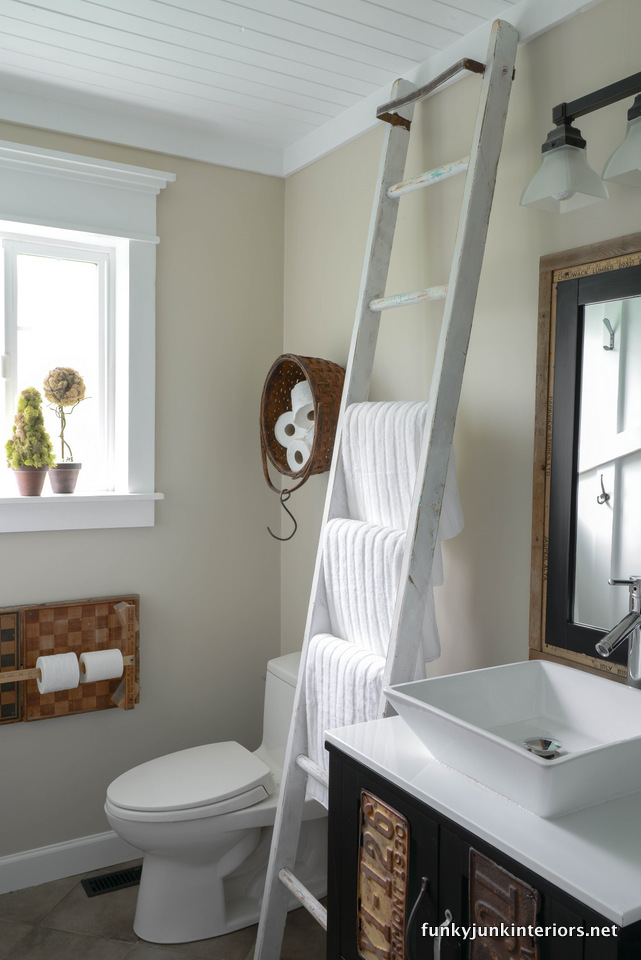 Ladder towel holder / Bathroom storage ideas in Cabin Life! on FunkyJunkInteriors.net