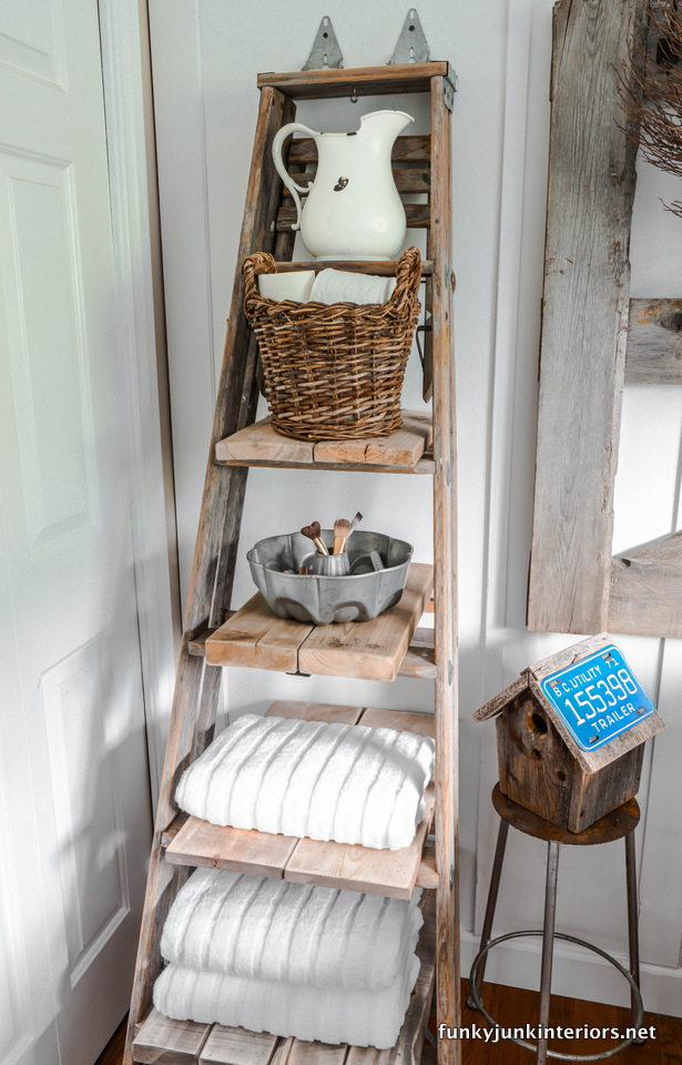 Ladder towel shelf / Bathroom storage ideas in Cabin Life! on FunkyJunkInteriors.net