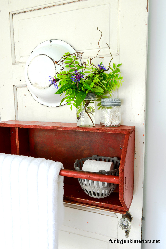 Toolbox turned towel holder / Bathroom storage ideas in Cabin Life! on FunkyJunkInteriors.net