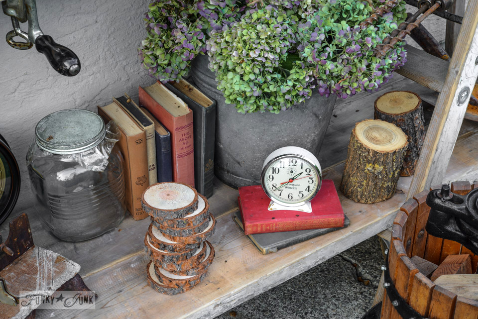 Old books, candy jar, clock, galvanized bucket / How to survive an antique auction - tips and see the loot! via FunkyJunkInteriors.net