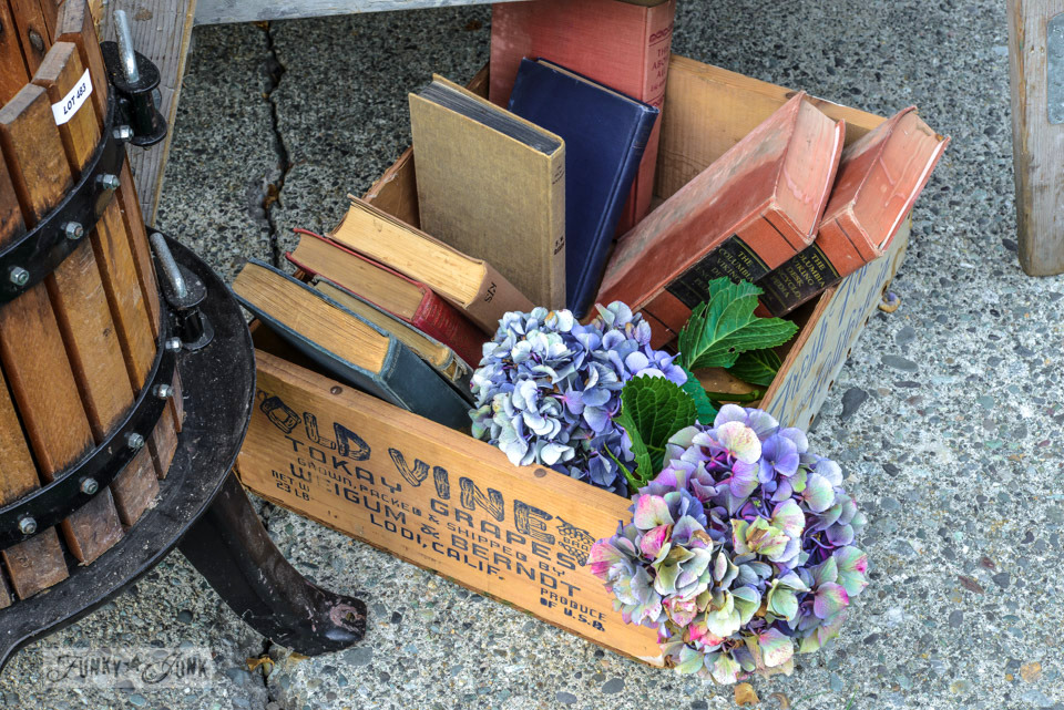 Old books and grape crate / How to survive an antique auction - tips and see the loot! via FunkyJunkInteriors.net