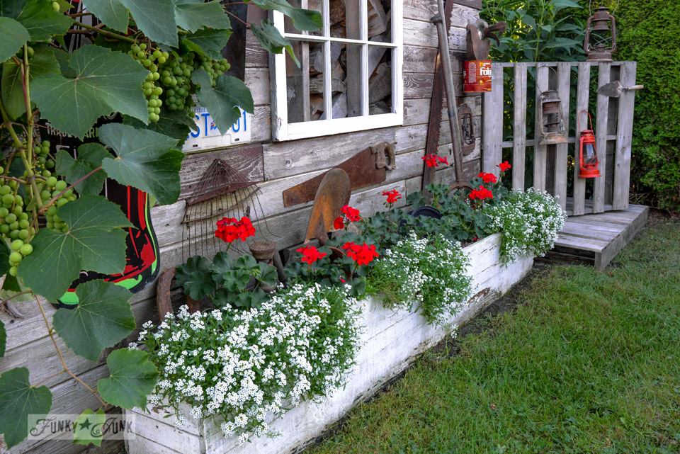 red geraniums blooming in crates / Funky Junk's 2015 Summer Home Junk Tour / FunkyJunkInteriors.net