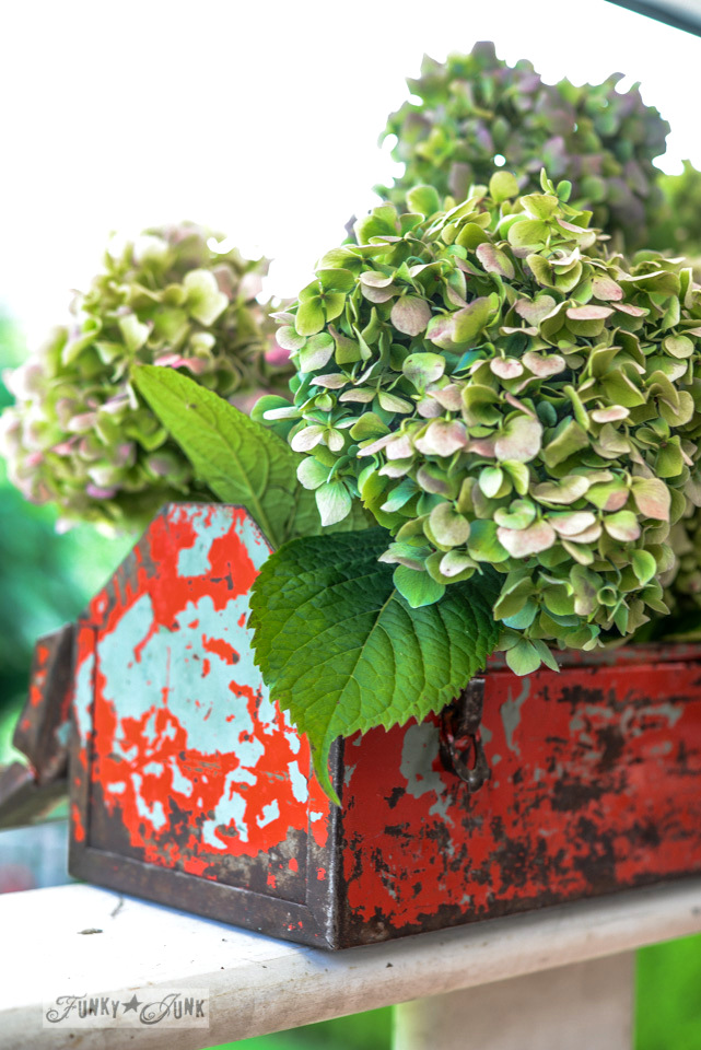 Green hydrangeas / A milk painted pallet wood tray in tricycle / via FunkyJunkInteriors.net