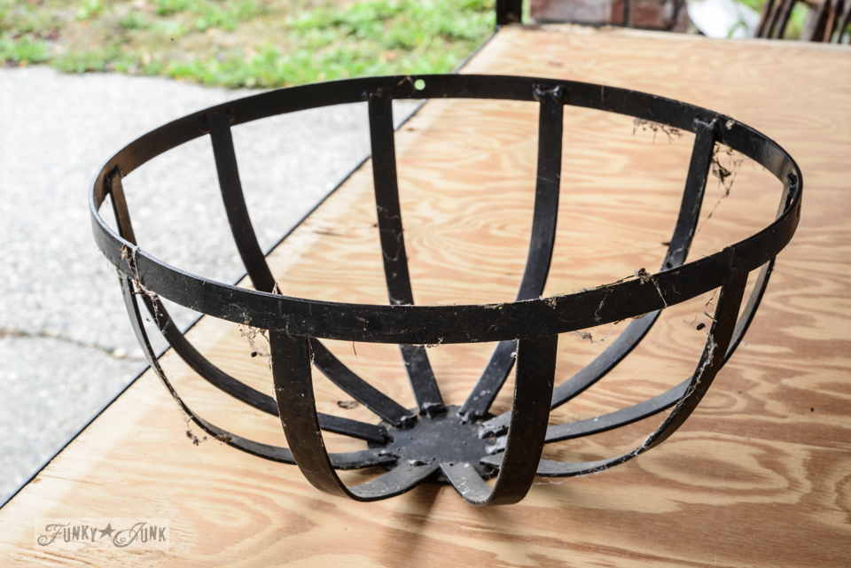 black metal basket / A curbside metal rack welcomes me home / FunkyJunkInteriors.net
