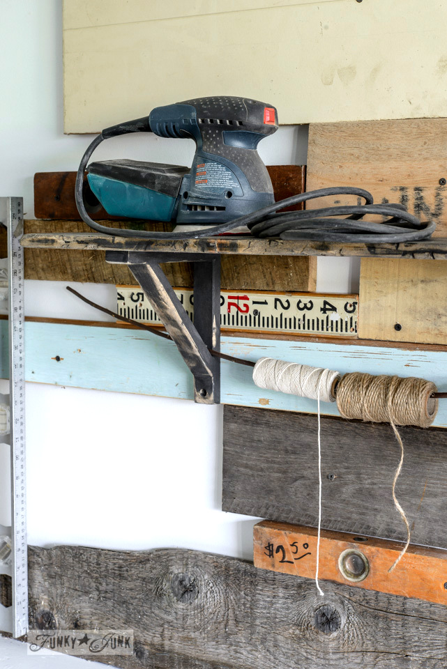 Shelf turned tape and twine storage / How to distress a new shelf into a dumpster find - with heavily distressed edges via FunkyJunkInteriors.net