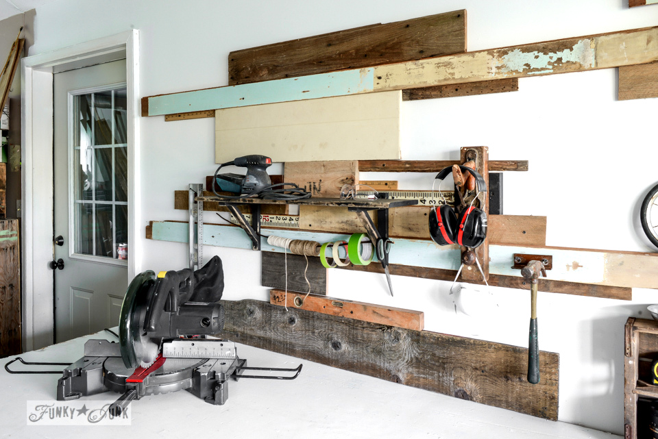 Reclaimed wood wall and junky storage in the workshop - FunkyJunkInteriors.net