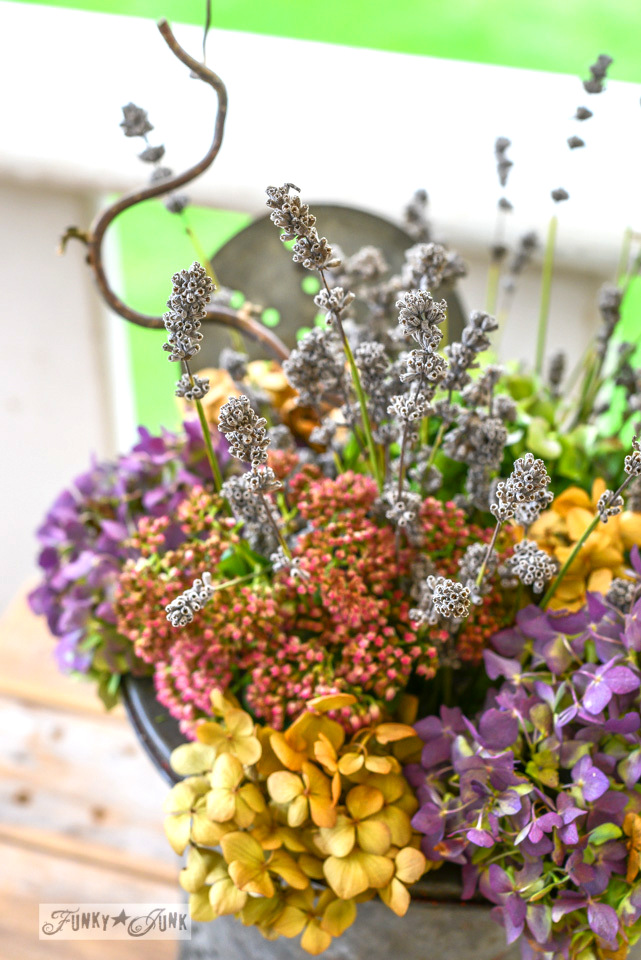 When neglected fall flowers emerge / colourful fall flowers in a bait bucket... via FunkyJunkInteriors.net