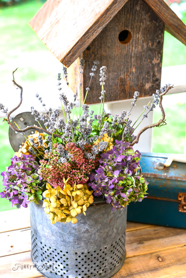 Fall flowers in a minnow bucket by FunkyJunkInteriors.net