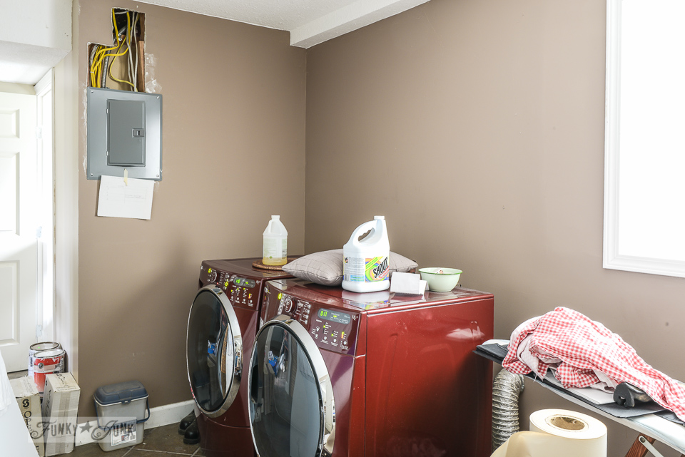 Laundry room before with dark walls / Funky new wall for the laundry room via FunkyJunkInteriors.net