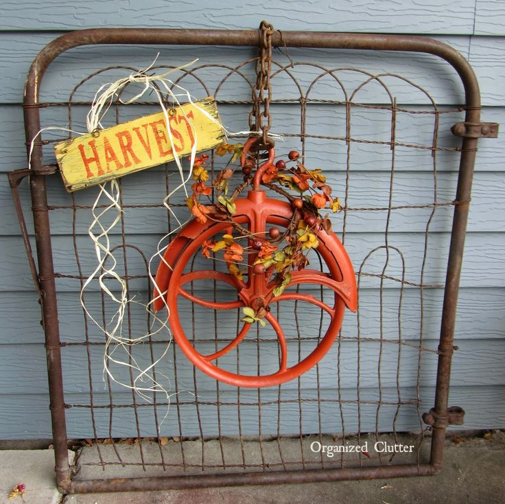 Salvaged pulley wreath for fall display / Organized Clutter on FunkyJunkInteriors.net