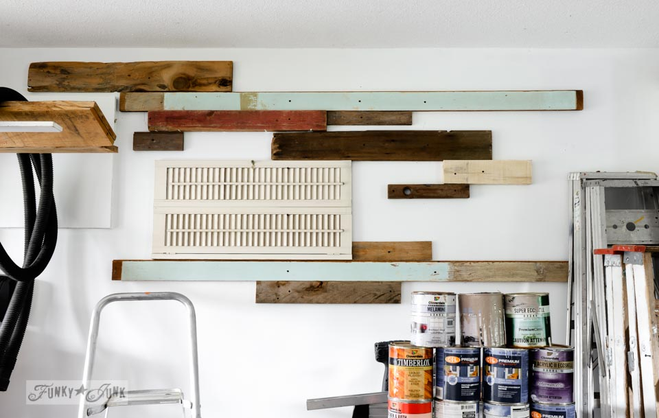 Reclaimed wood patchwork quilt wall treatment / FunkyJunkInteriors.net