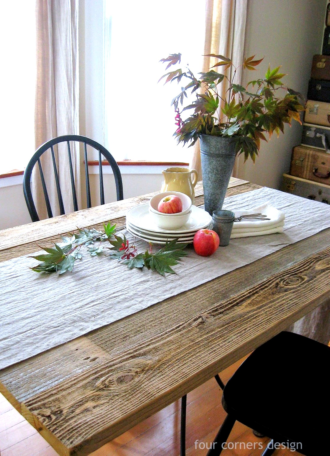 DIY reclaimed wood dining table by Four Corners Design featured on FunkyJunkInteriors.net