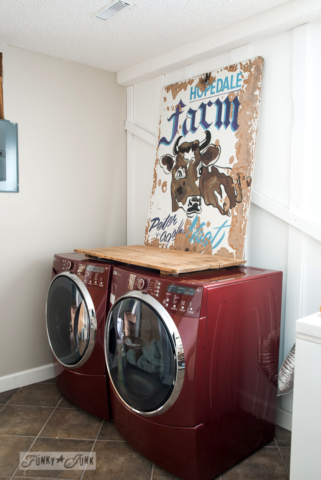 Old sign and reclaimed wood washer and dryer protector / Funky new wall for the laundry room via FunkyJunkInteriors.net