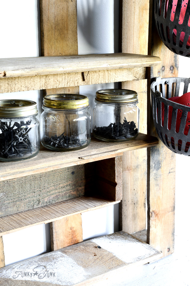 Pallet shelf in the workshop via FunkyJunkInteriors.net