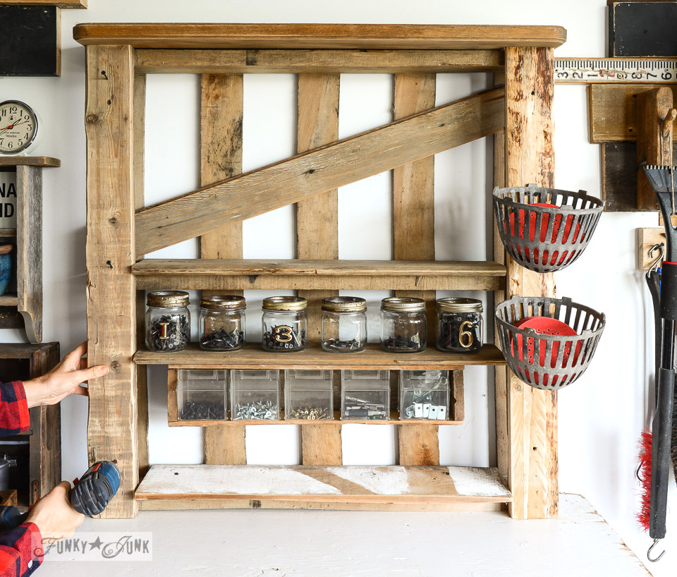 adding reclaimed wood as side supports / Organize your tools on an enhanced pallet shelf via FunkyJunkInteriors.net