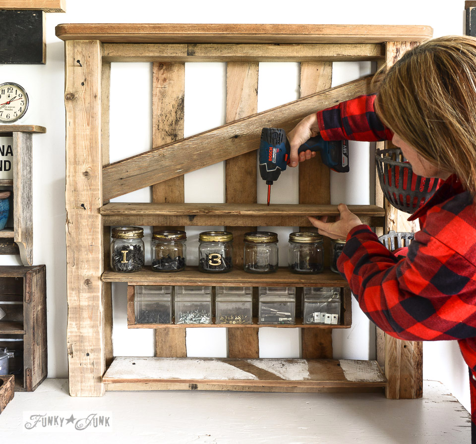 adding reclaimed wood as shelves / Organize your tools on an enhanced pallet shelf via FunkyJunkInteriors.net