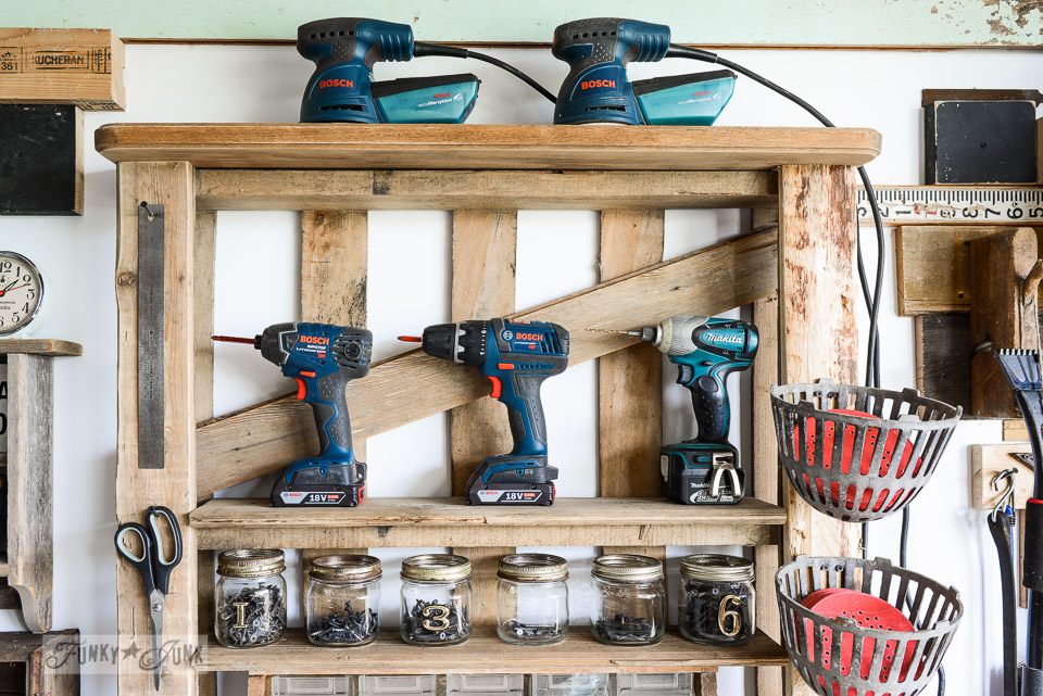 cordless drills, palm sanders and screws / Organize your tools on an enhanced pallet shelf via FunkyJunkInteriors.net