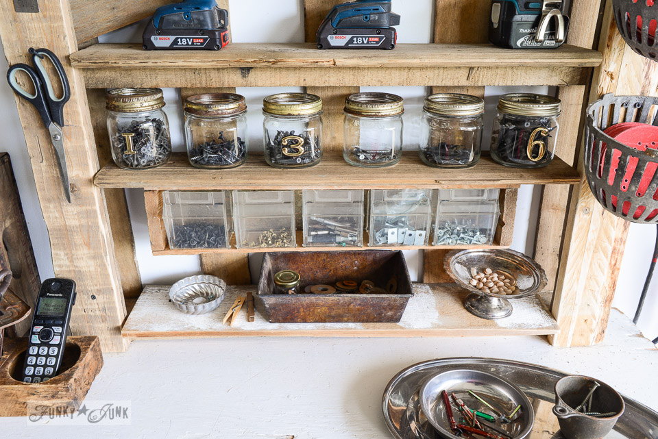 mason jar screw storage / Organize your tools on an enhanced pallet shelf via FunkyJunkInteriors.net