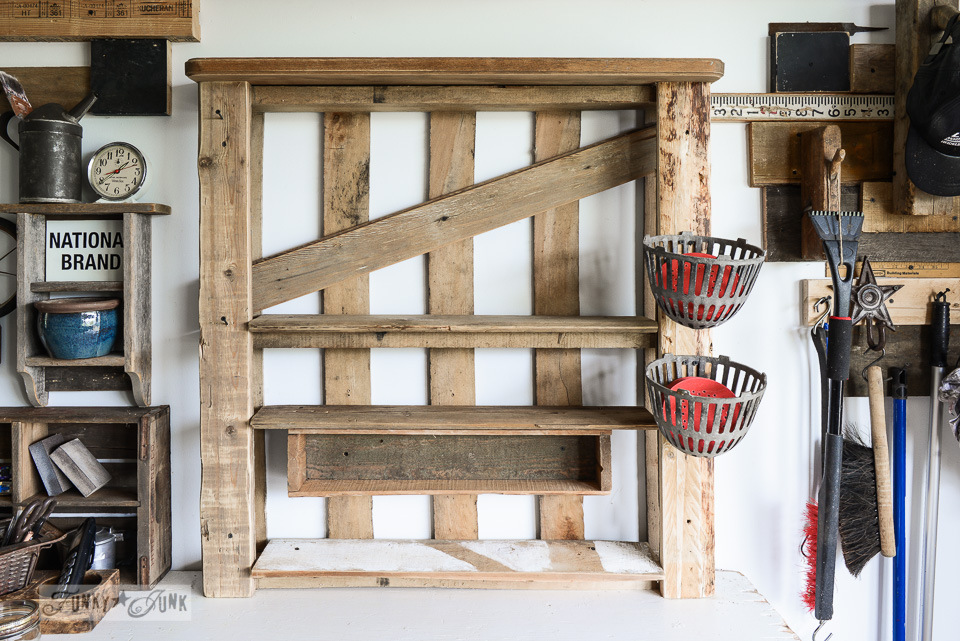 attach a board to a crate for a shelf / Organize your tools on an enhanced pallet shelf via FunkyJunkInteriors.net
