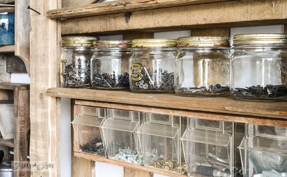 screw storage in mason jars / Organize your tools on an enhanced pallet shelf via FunkyJunkInteriors.net