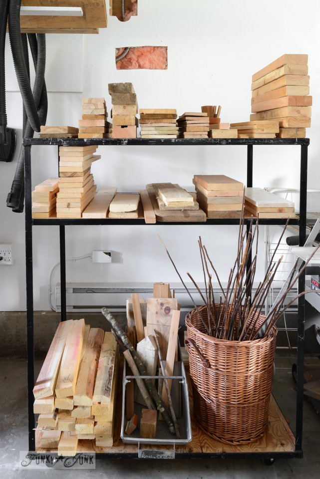 Reclaimed wood storage rack in a workshop / FunkyJunkInteriors.net