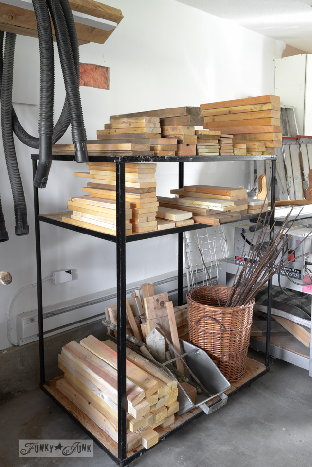 curbside found rolling stand to store and organize reclaimed wood in a workshop / funkyjunkinteriors.net