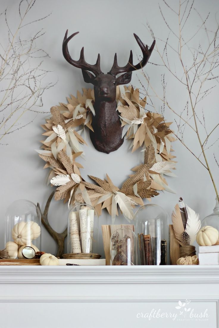 Paper feather wreath, by Craftberry Bush, featured on FunkyJunkInteriors.net