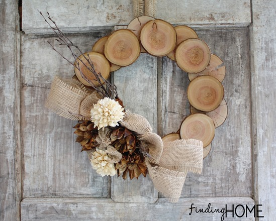 Wood slice wreath by Finding Home, featured on FunkyJunkInteriors.net