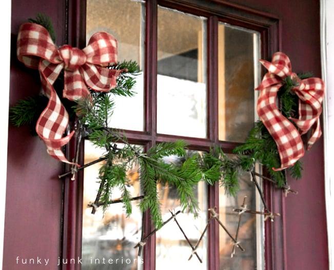 Zig zag twig garland on a front door on FunkyJunkInteriors.net